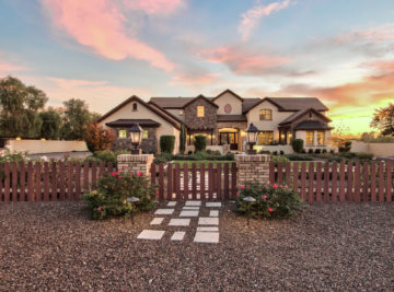 French country estate exterior front view of house with AZ sunset in background.