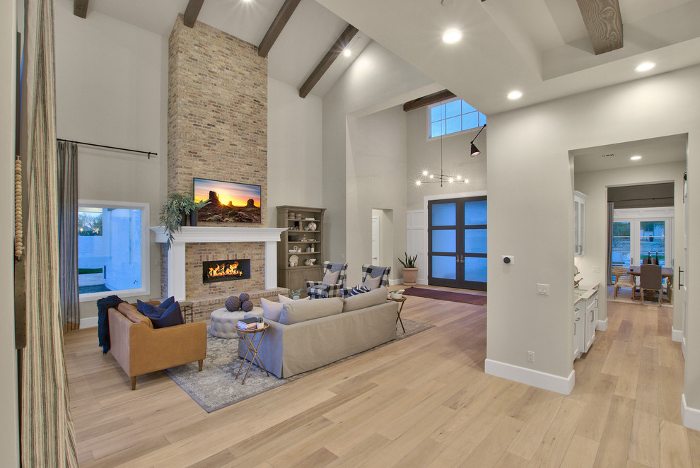 Modern-Farmhouse-Living-Room-Design-Featuring-High-Ceiling-Beam-Work 1