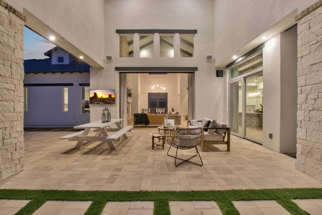 Modern-Farmhouse-Design-Featuring-Sliding-Glass-Wall-to-Courtyard-Patio
